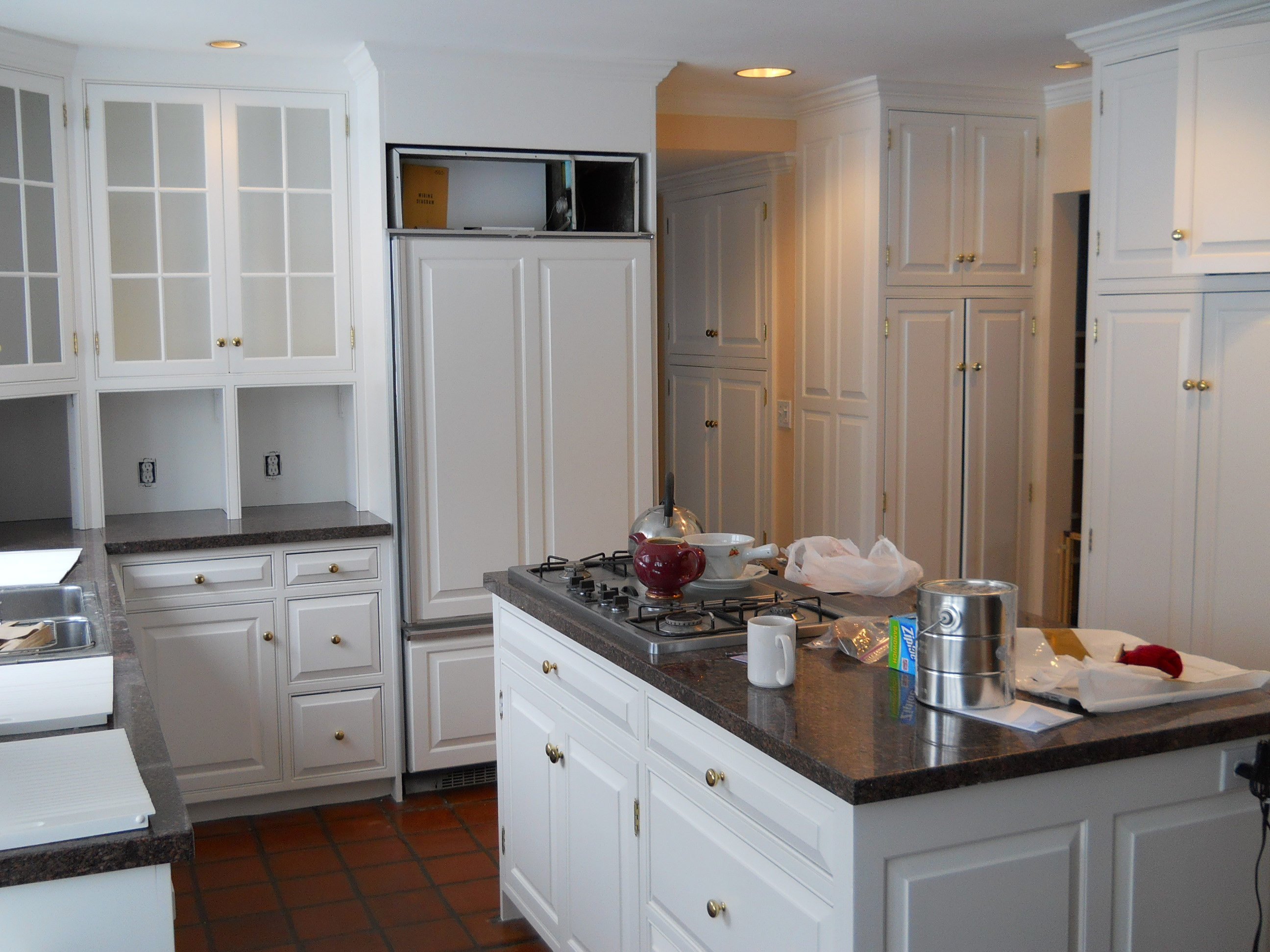 Painting Kitchen Cabinets White in Denver, CO by Eco Paint, Inc